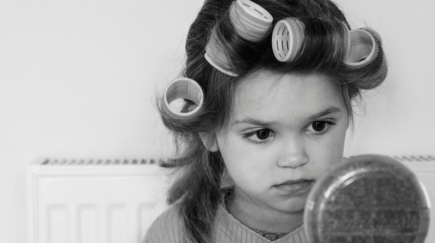 Canva stock photo little girl in curlers