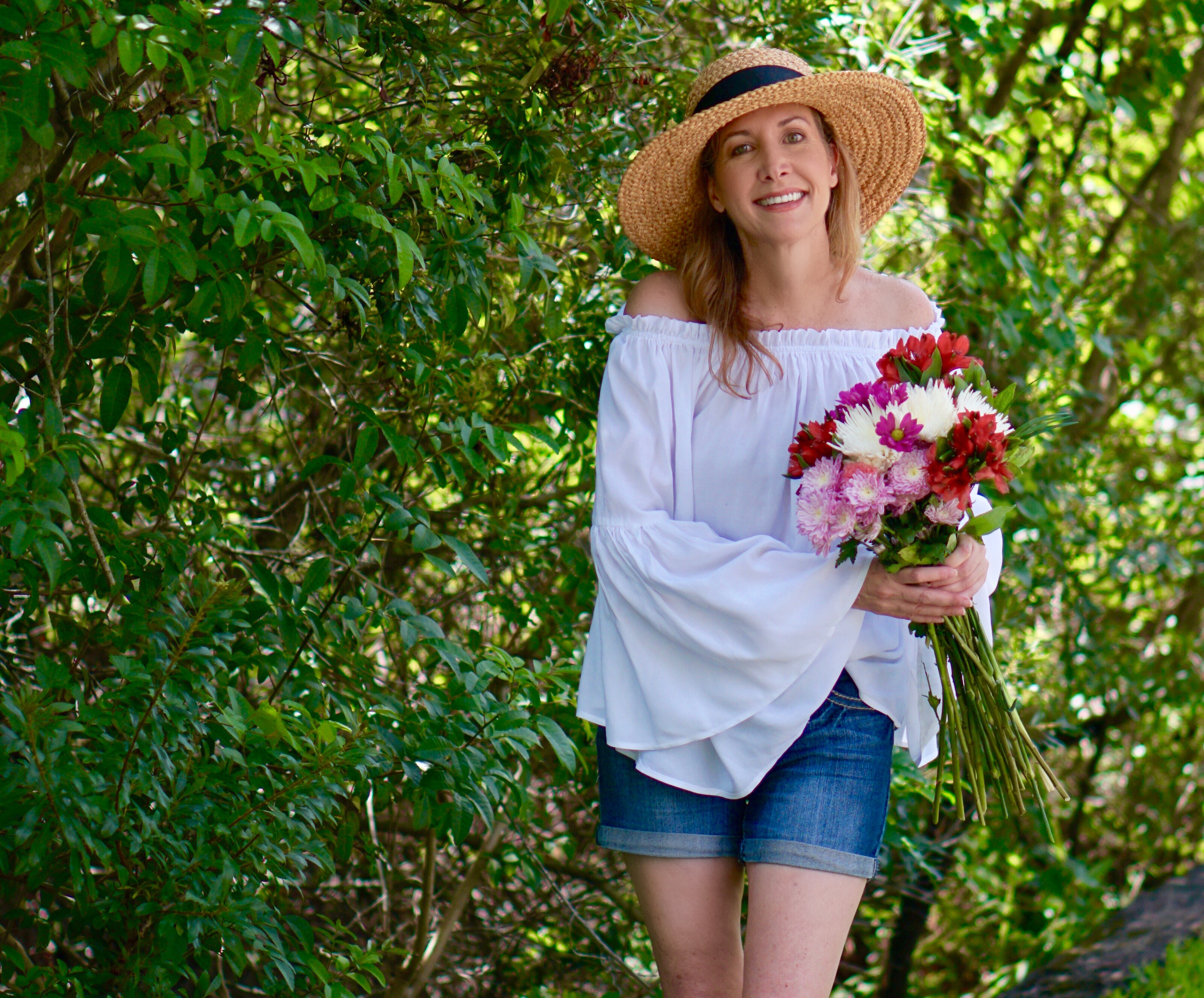 Sharing A Journey blog-white top with cutoffs and hat