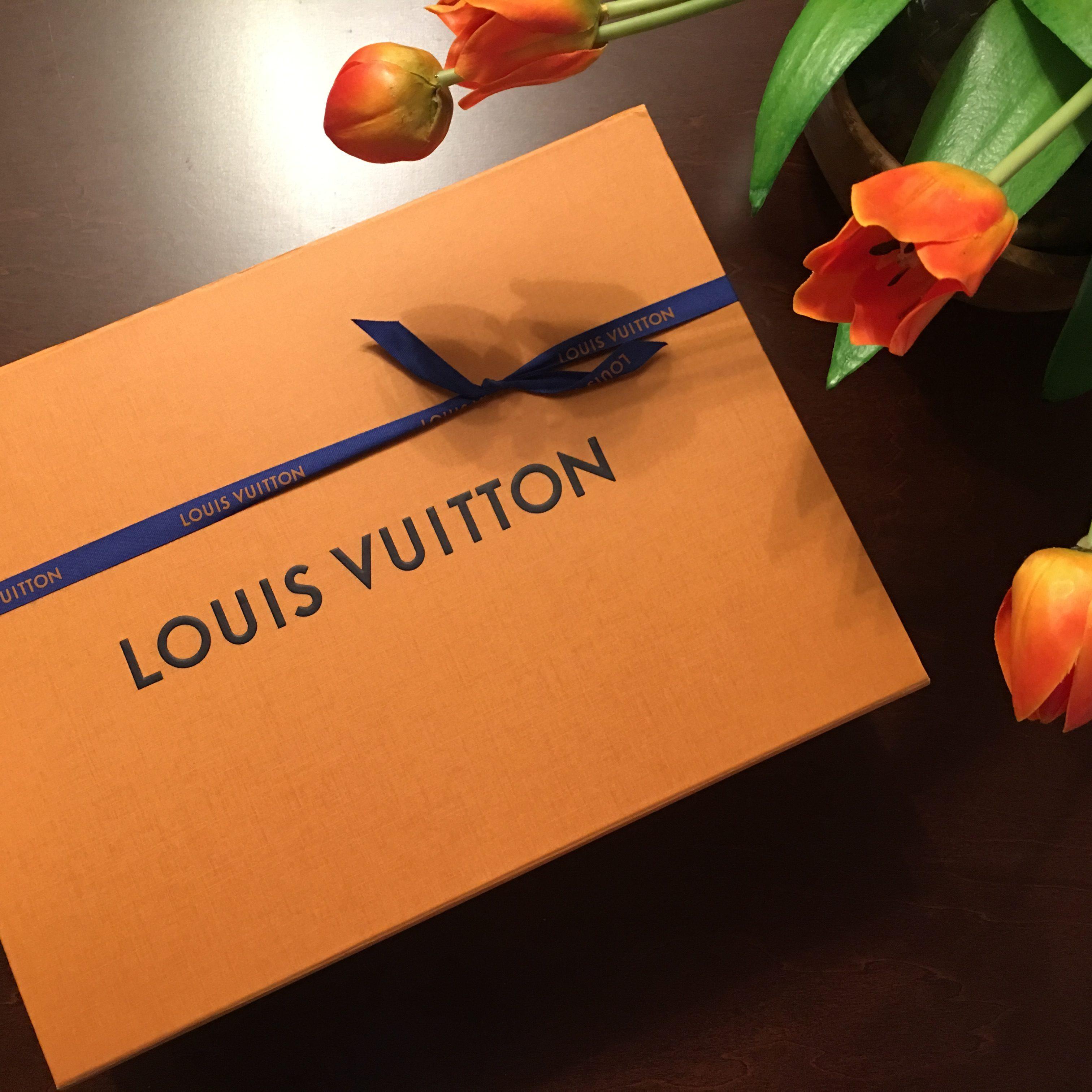 Orange Louis Vuitton box with blue ribbon
