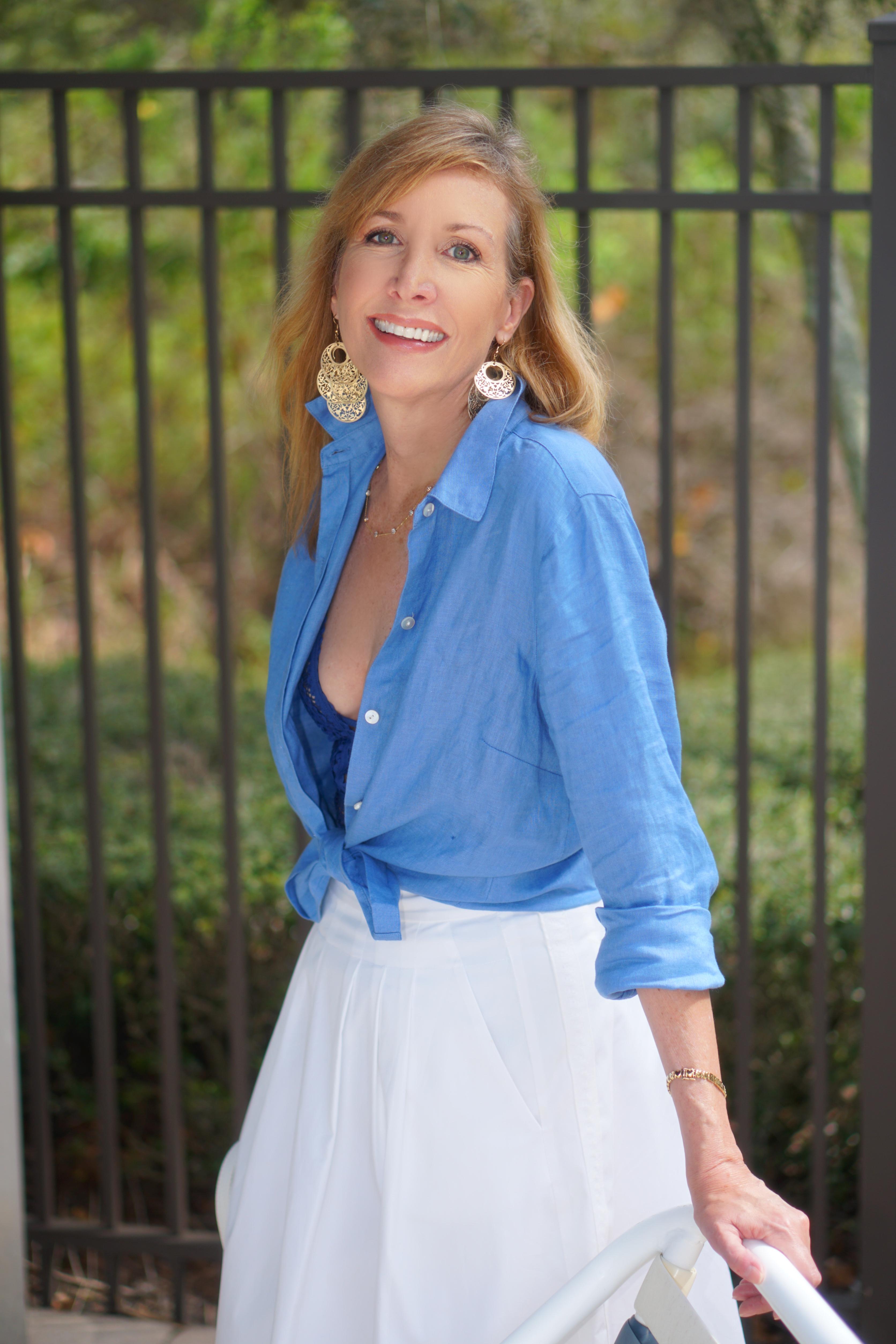 Nina Bandoni sharing a journey wearing a blue blouce and white skirt
